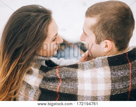 Young Woman And Man Bundled Plaid On Winter Picnic.