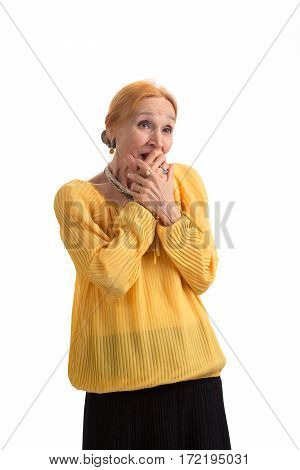 Surprised woman covering mouth. Amazed senior lady isolated. Witness the magic.