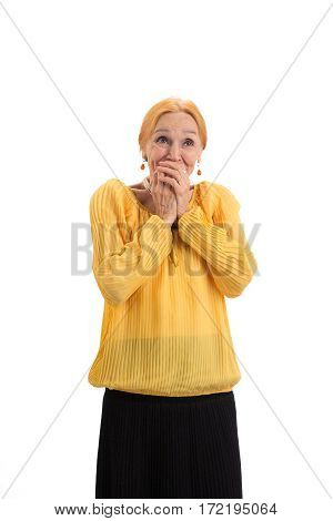 Surprised lady covering mouth. Amazed senior woman isolated. Wonders are real.