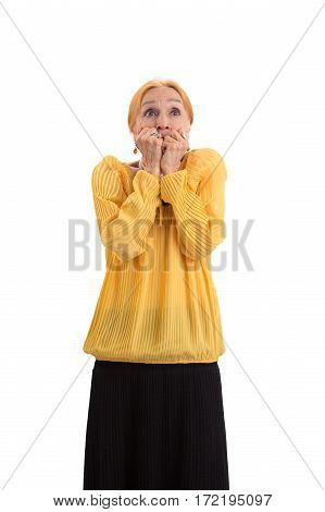 Scared woman covering mouth. Frightened senior lady isolated. Do not panic.