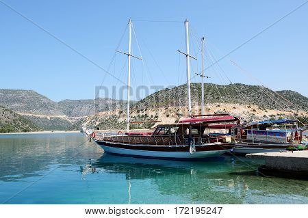 ANTALYA TURKEY - APRIL 24: The yacht in harbor on Turkish resort on April 24 2014 in Antalya Turkey. More then 36 mln tourists have visited Turkey in year 2014.