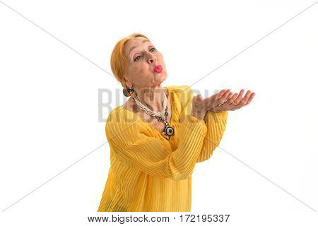 Woman sending air kiss. Elderly female on white background. Gesture of love.
