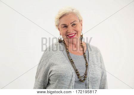 Elderly woman smiling isolated. Senior lady with happy face. Form a positive mindset.