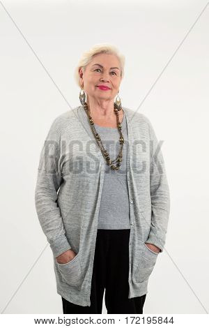 Elderly woman standing isolated. Senior lady on white background. How to look confident.