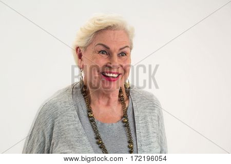 Isolated elderly woman smiling. Lady with happy face expression.