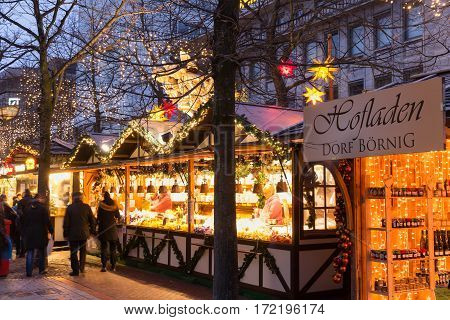 DUISBURG GERMANY - DECEMBER 17 2016: Illuminated Christmas fair kiosk on traditional christmas market in the center of Duisburg Germany