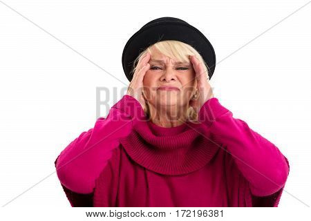 Senior woman having headache. Lady in pain touching head.