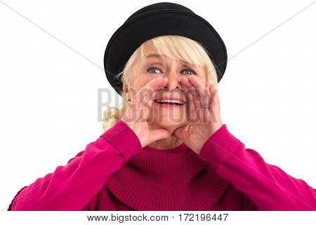 Senior lady is shouting. Woman holds hands near mouth.