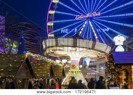 DUISBURG GERMANY - DECEMBER 17 2016: Traditional christmas market with illuminated carrousel and ferris wheel in the center of Duisburg Germany
