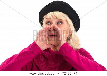 Senior woman is shouting. Female holds hands near mouth.