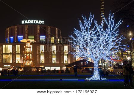DUISBURG GERMANY - DECEMBER 17 2016: Traditional christmas market with illuminated tree in the center of Duisburg Germany