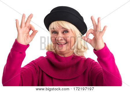 Senior lady showing ok gesture. Woman happily smiling isolated.