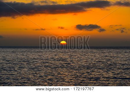 The sun sets over the Pacific Ocean in Maui