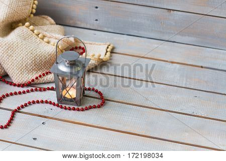 Christmas Lanterns, Plaid And Red Beads On Light Wooden Background.