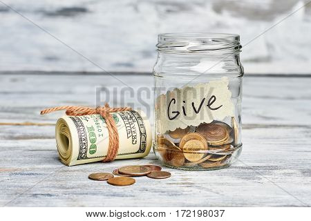Dollars in roll and coins. Help those in need.