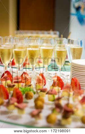 Glasses Of Champagne And Strawberries