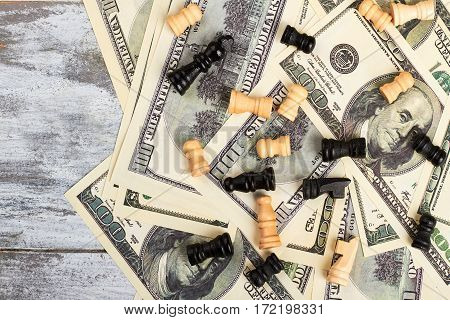 Chess and money. Strategic financial game. Wooden chess on the dollars.