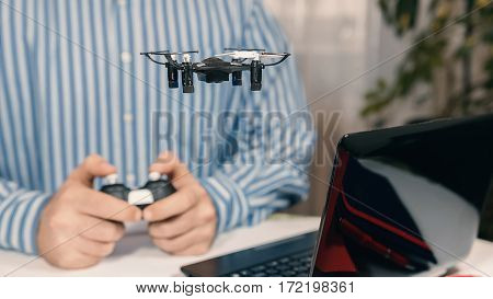 Businessman Playing With Drone Toy To Relieve Stress At Work.