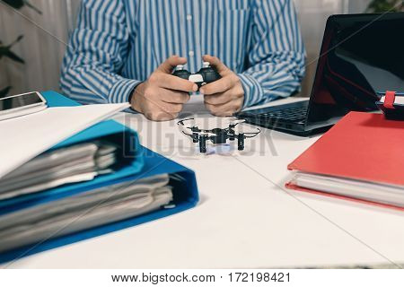 Businessman Playing With Drone Toy At The Office. Office Playing.