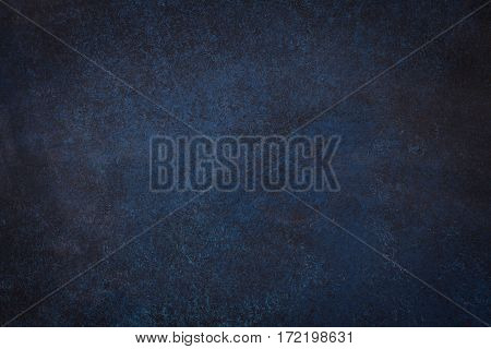 Dark blue black slate background or texture.