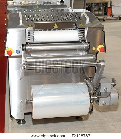Automated Foil Packaging Machine in Food Factory