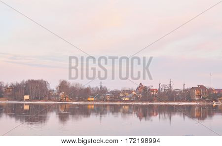 View of Neva River on the outskirts of St. Petersburg at spring evening Russia.
