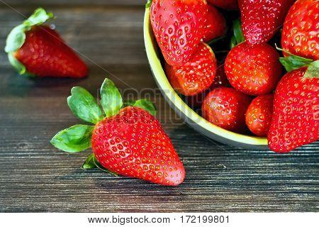 Bowl full of fresh juicy and sweet strawberries.