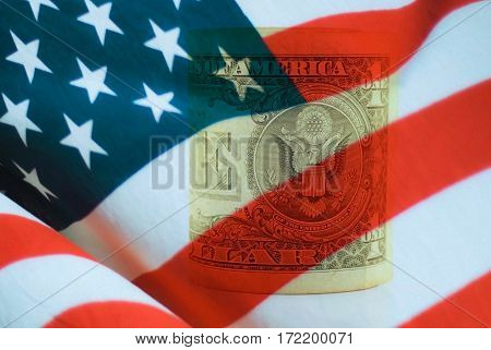 rolled one dollar bill with United states flag
