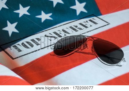 Top secret stamp with sunglasses and United states flag