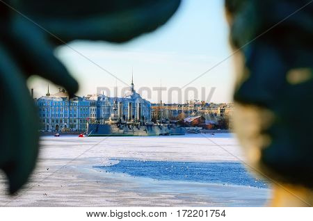 The cruiser Aurora in winter on the frozen river St. Petersburg. Silhouette of the person drawing of the bridge