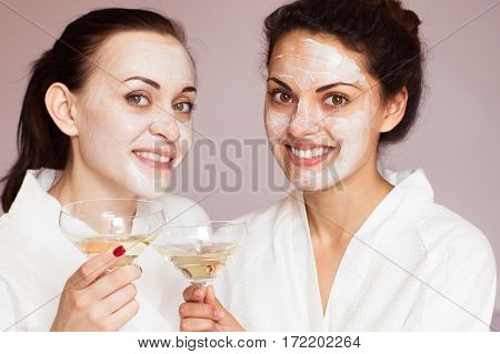 Smiling Girlfriends With Champagne In The Spa