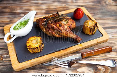 Tasty Grilled Chicken Lag And Rosemary On Wooden Background.