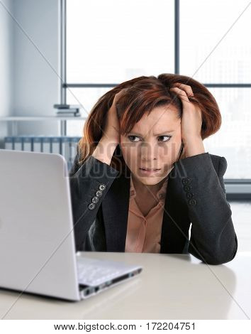 young busy beautiful business woman suffering stress working at office computer desk worried and desperate at work in overwork concept