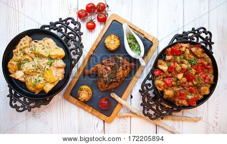 Overhead View Of Colorful Roast Vegetables, Savory Sauces Served With Grilled Chicken Leg On A White