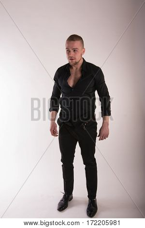 Good Looking Man Wearing Black Shirt And Black Pants. Casual Wear. Expressions. Studio Portrait Isol