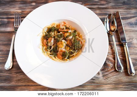 Italian Paste With Quail Egg And Shrimps On A Dark Wooden Background