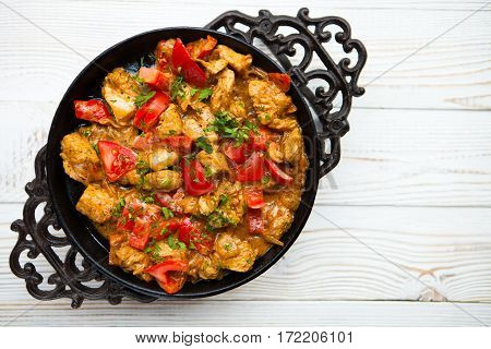 Chicken With Vegetable On Frying Pan On White Wood Background