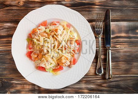 Tasty Shrimps And Grapefruit Salad Decorated With Cheese