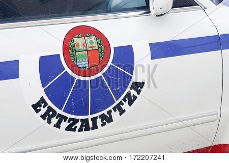 VITORIA SPAIN - FEBRUARY 19 2017: Ertzaintza logo in one of their cars. Ertzaintza is the police force for the autonomous community of Basque Country Spain.