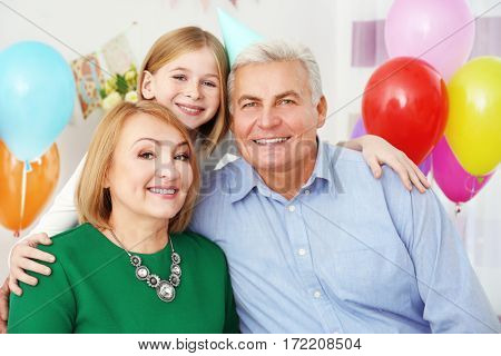 Grandparents with their grandchild at  birthday party