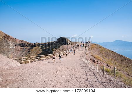 Mount Vesuvius Italy - August 30 2016: Tourists walk around the crater of Mount Vesuvius one of the most dangerous volcanoes in the world.