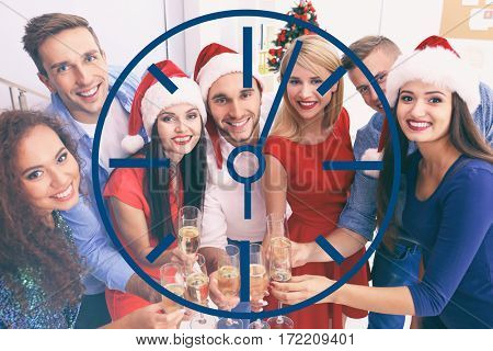 Time concept. Young people with glasses of champagne on Christmas celebration at corporate party