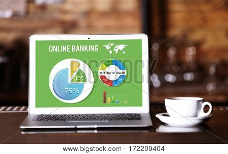 Online banking concept. Laptop on bar counter