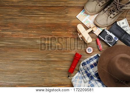 Traveller's accessories on wooden background