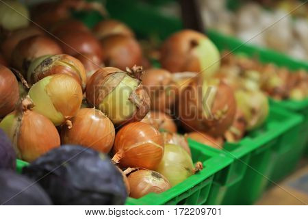 Fresh vegetables in plastic boxes on market