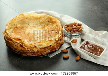 Delicious pancakes, almonds and chocolate mousse on table