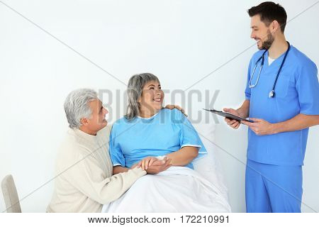 Senior man visiting wife in hospital