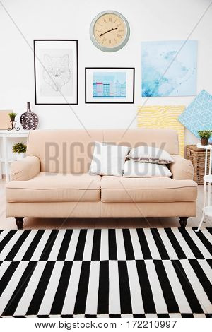 Sofa in modern room interior