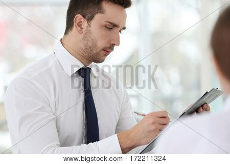 Job interview concept. Human resources manager with clipboard, closeup