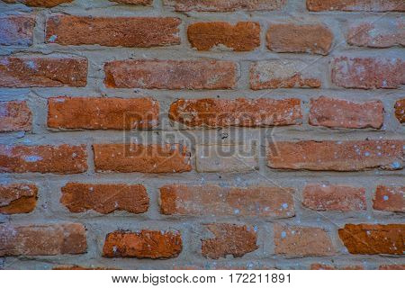 red brick wall with grey line filling